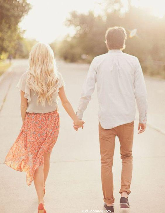 A walk with lover holding hands image