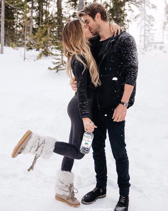 Romantic love kiss in the snow image