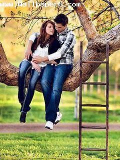 Boy and girl romancing on tree