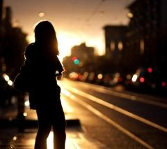 Girl walking on street to
