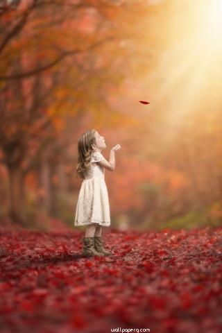 Girl playing with leaf hd wallpaper