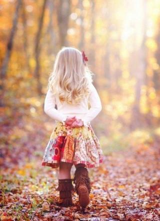 Girl walking on leaves