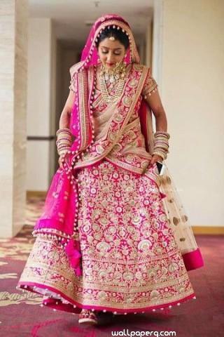 Bride in pink attire read