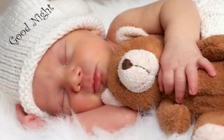 Baby with teddy good nigh