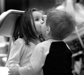 Cute kids kissing couple