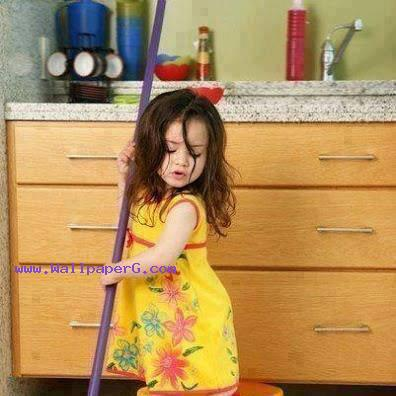 Sweet baby with broom