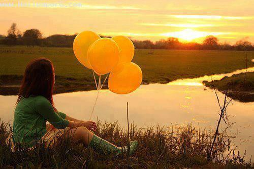 Girl along the ballons