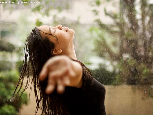 Girl enjoying monsoon ima