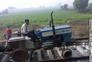 Indian tractor on train tracks jugaad