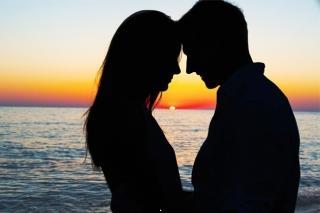 Romantic sunset couple meet