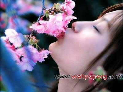 Girl kissing flower